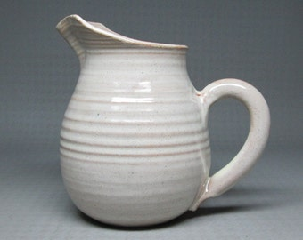 Rowantrees pottery pitcher Bluehill Maine , dated 94