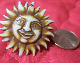 """2X1.25"""" inches, realistic face in sun rays, or petal rim. Celluloid molded, cream and brown tones. 1 hole attachment.WCKG(mem)14.7-7.11-6"""