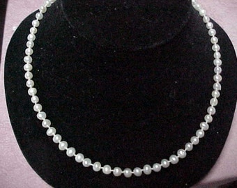 "A Vintage Strand of Cultured Pearls from the 1950's, 15"" of Snow White Pearls, 5MM, 925 'Fish' Clasp"