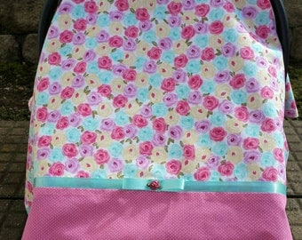 Car Seat Canopy for Girl. Floral print of Roses with coordinating fabric in Pink with small polka dots.