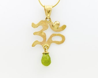 Hand Carved 14K Gold OM Pendant with Peridot Briolette Fine Handmade Jewelry Gold Peridot Necklace Sanskrit Yoga Symbol