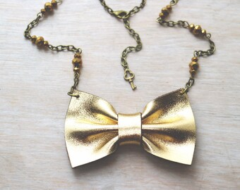 Golden bow tie necklace.  Genuine leather bow pendant. Romantic. Boho chic, Gold, Kawaii Lolita. classic outfit.