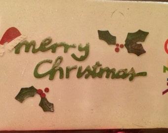 Sizzix Medium Sizzlit Die  655183  MERRY CHRISTMAS  santa hat holly berries
