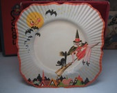 RESERVED 4 D 1930's Halloween paper plate showing a young white haired witch on her broom with black hissing cat,full moon,bats,rooftops