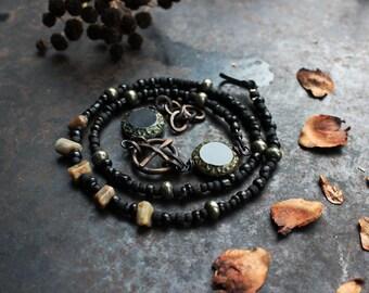 Solar cross bracelet, wrap amulet bracelet, black triple bracelet, rustic sun cross bracelet, sun emblem bracelet, norse bracelet