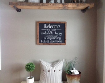 Welcome to our comfortable, happy, sometimes loud, usually messy, full of love home sign. Barn wood frame
