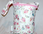 "Wet bag in birds and flowers print! 9""x12"" perfect travel size! fits approximatley 4 cloth diapers"