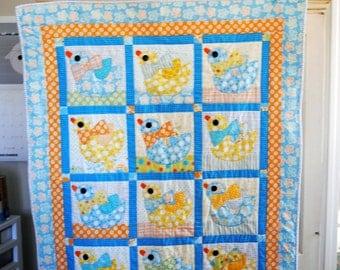 Appliqued baby quilt