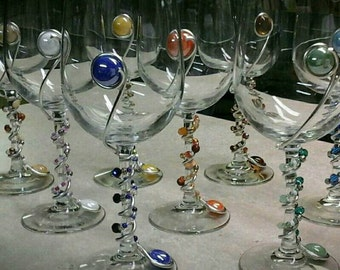 Wine glasses decorated with beads and flat gems.