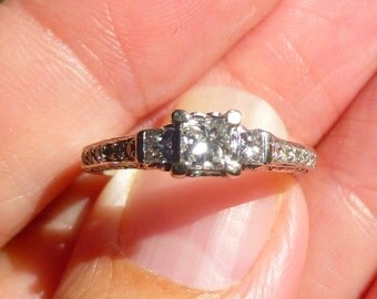 Beautiful engagement ring 1 ct total weight .35 point center  Princess and  14KT white gold