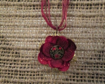 Small 1 1/4 inch silk flower necklace - Red with antiqued center and red Rhinestones.