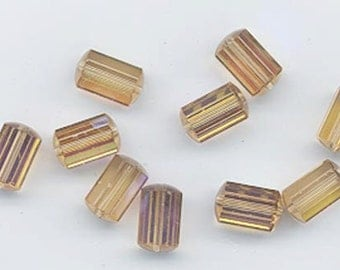 12 pieces vintage Swarovski faceted cylindrical crystals - art. 5230 - 9 x 6 mm - light colorado topaz AB