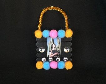 Black Pink and Orange Frida Kahlo Pom Pom Wooden Popsicle Stick Ornament