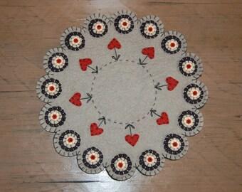 Wool felt penny candle mat