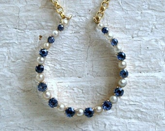 Vintage 14K Yellow Gold Pearl and Sapphire Horseshoe Necklace.