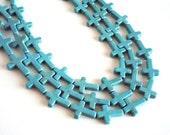 "Turquoise Howlite Cross Beads, 16x26x4mm - 16"" strand"