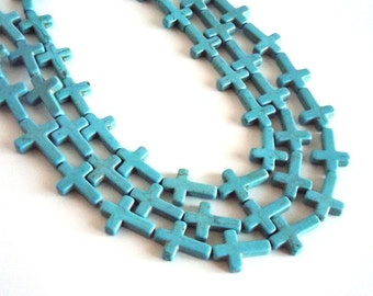 "Turquoise Howlite Cross Beads, 16x26x4mm - 16"" strand"