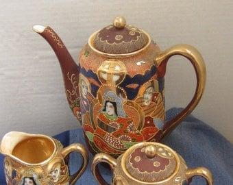 A Beautiful-Japanese-Tea-Set-Raised-Hand-Painted-Gooseneck-Teapot-Sugar-Creamer