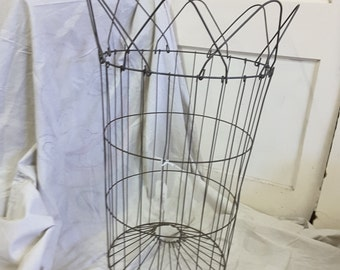 Vintage French wire laundry hamper.