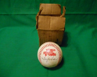 One (1), 1980 Rawlings, World Series Baseball, signed by Tug McGraw.