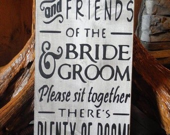 Family and friends of the groom sign