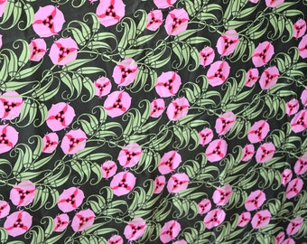 Passion vine material in pink and green.  Nigella Amy Butler for Rowan fabrics
