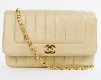 Vintage CHANEL beige lambskin 2.55 classic flap shoulder bag with golden CC. Best and most popular purse with vertical stitch.