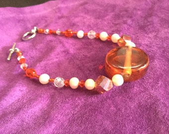 bracelet made with orange glass beads freshwater pearls and svorsky crystal