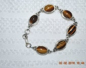 "Sterling silver Tiger eye stone bracelet 7 1/2"" Beautiful setting & design"