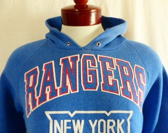 vintage 80's New York Rangers NHL Hockey sports team blue graphic hoodie sweatshirt red white puffy print logo raglan sleeve made in usa Lg