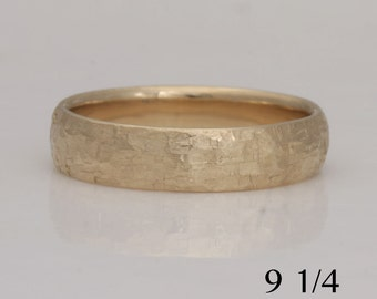 14k yellow gold  band, size 9 1/4, rustic texture, #757.
