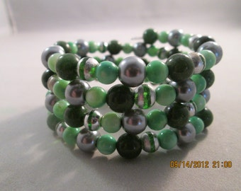 4 Row Memory Wire Cuff Bracelet with Shades of Green Beads and Silver Tone Beads
