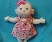 "Fretta's Flower BeBe Doll. Fair Skin, Blue Eyes Bald Baby. 40.6 cm / 16"" Soft sculpture Baby Girl. Child Friendly Cloth Doll."