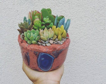 Agate accented concrete planter with succulent garden
