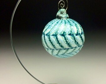 Green and white hand blown glass ornament.