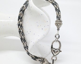 Black and white viking knit bracelet with heart clasp