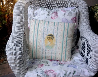 Throw pillow made from vintage ticking, a vintage lace doily and an romantic oval female portrait floral print ticking with blue stripes