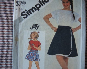 vintage 1980s Simplicity sewing pattern 5556 UNCUT girls jiffy reversible front wrap skirt in two lengths and pullover top