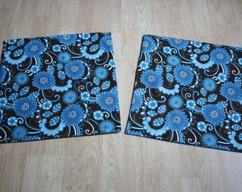 A pair of brown and teal envelope-style cushion covers