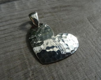 Sterling silver hammered heart pendant.