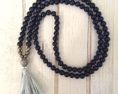 Navy blue dyed jade mala bead necklace with pyrite beads and light blue tassel