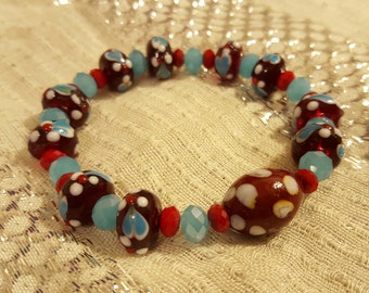 BRACELET: Beautiful Lampwork Beaded Stretch Bracelet with Light Blue and Cherry Red Swarovski Crystal Spacer Beads