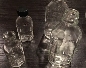 Four Small Vintage Glass Apothecary Bottles