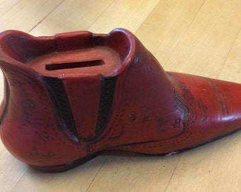 Vintage piggy bank shaped as a western boot