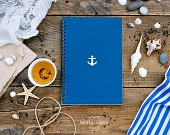 Blue notebook-sketchbook with anchor carved pattern