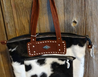 Cowhide and leather purse/bag