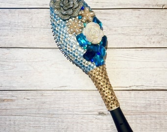 Sparkly BLING brush with blue, clear and champagne crystals and flowers.