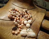 RESERVED Estate  Vintage Carved Angel skin Coral Fruit pendant and carved beads necklace