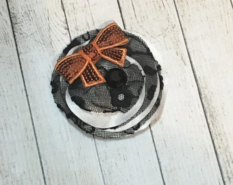 Black and white Halloween hair clip with orange bow