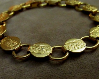 Delectible Sarah Coventry Gold Tone Floral Disc Art Deco Link Bracelet from the Young and Gay Collection